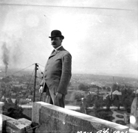 Cass Gilbert, MN State Capitol Architect, standing near the dome at the top of the capitol. May 9, 1901.